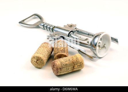 Isolated corks and corkscrew with white background - Stock Photo