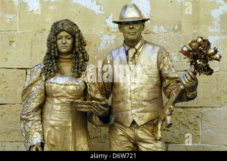 Mime artists painted in gold in Valleta Malta - Stock Photo