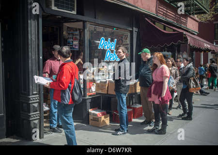 Shoppers line up outside Rebel Rebel records on Bleecker Street in the Greenwich Village neighborhood of New York - Stock Photo