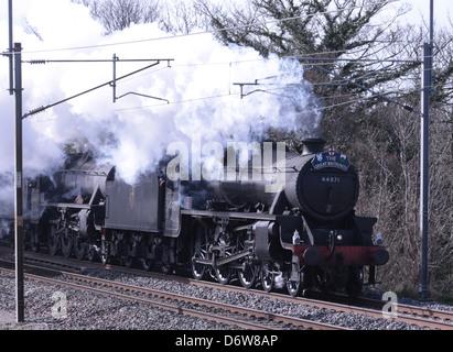 Great Britain VI steam railtour heading along the West Coast Main Line towards Lancaster hauled by two Stanier black - Stock Photo