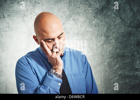 Businessman worry. Young adult bald businessman having problems. - Stock Photo