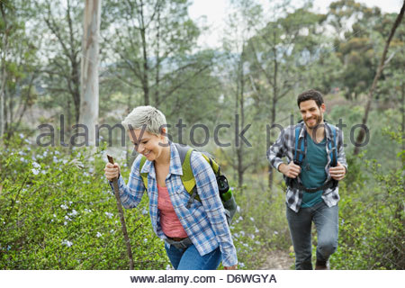 Happy couple hiking in park - Stock Photo