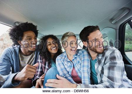 Cheerful friends enjoying road trip - Stock Photo