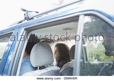 View through window of friends on road trip - Stock Photo