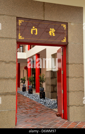 Red temple door and bonsai plants - Stock Photo
