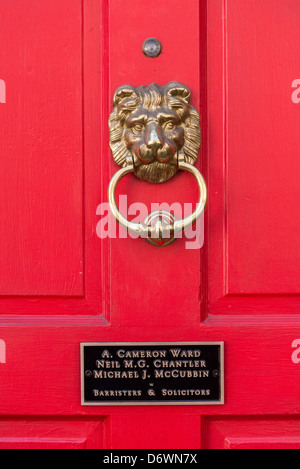 Barristers door with lion knocker. - Stock Photo