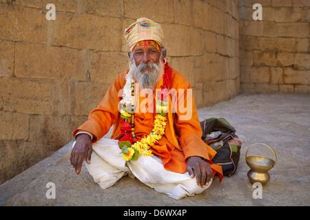 Portrait of smiling India Hindu Holy Man, Sadhu, Jaisalmer Fort, Rajasthan, India - Stock Photo