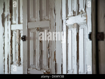 Neglected cabinets with peeling paint. - Stock Photo