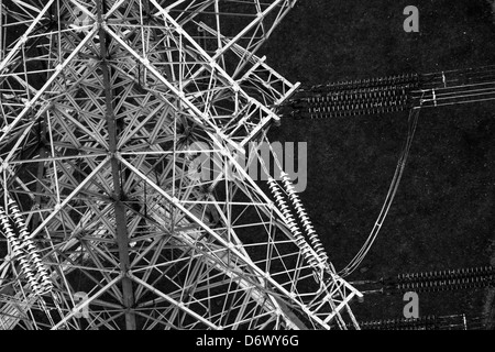 Close up black and white aerial photograph showing details power lines and pylon - Stock Photo