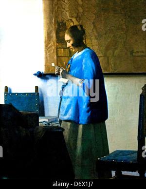 Woman Reading a Letter 1663 Johannes Vermeer 1632 - 1675 Dutch Netherlands - Stock Photo