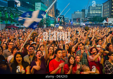 MONTREAL - JUNE 15 - fans attending a Loco Locass concert during francofolies festival on 2012/06/15 - Stock Photo