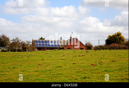 A view of solar energy panels on a bungalow roof at Surlingham, Norfolk, England, United Kingdom. - Stock Photo