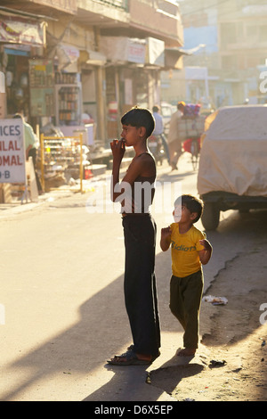 Young two indian children on the street of Jodhpur, Rajasthan State, India - Stock Photo