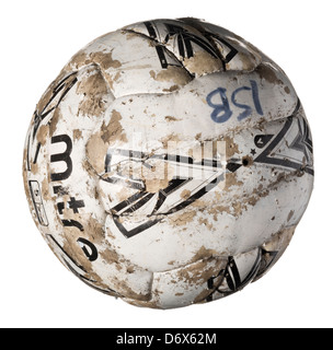 Old tired and worn out football - Stock Photo