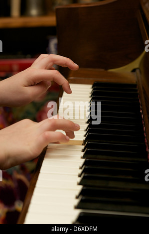 Young hands on piano keyboard - Stock Photo