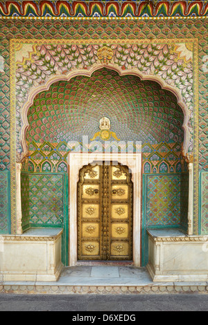 Art decorative entrance with door, Chandra Mahal, Jaipur City Palace, Jaipur, Rajasthan, India - Stock Photo