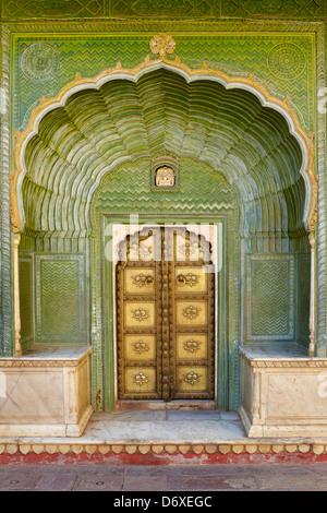 Decorative art entrance with door, Chandra Mahal, Jaipur City Palace, Jaipur, Rajasthan, India - Stock Photo