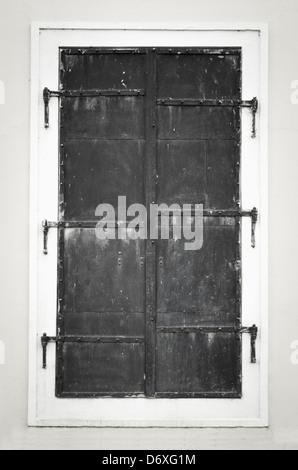 Decorative metal window on an old concrete wall. Monochrome photo. - Stock Photo