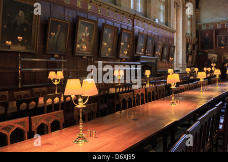 Historic Christ Church College Great Hall university dining room with lamps on long wooden tables. Oxford Oxfordshire - Stock Photo