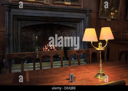 Fireplace in historic Christ Church College Great Hall university dining room setting for Hogwarts Hall. Oxford, - Stock Photo
