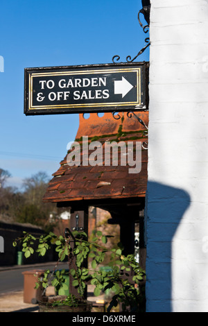 Exterior of a public house: sign pointing to the pub garden in the English village of Whitchurch on Thames, Berkshire, - Stock Photo