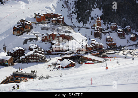 The snow covered chalets and apartments of Mottaret as viewed from above. Skiing in Meribel, France - Stock Photo