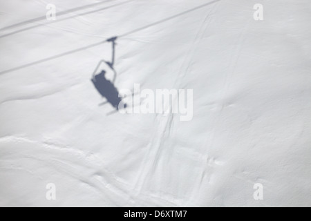 Shadows from a chairlift on the slopes. Skiing in Meribel, France - Stock Photo