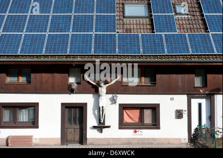 Kirchzarten, Germany, an old crucifix on a house with a modern solar system - Stock Photo