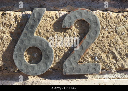 62 Tile numbered (door number) - Stock Photo