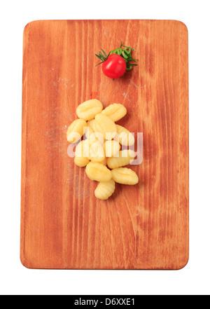 Boiled Italian dumplings on a cutting board - Stock Photo