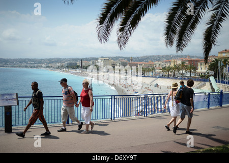 Nice, France, passers-by in front of the Promenade des Anglais - Stock Photo