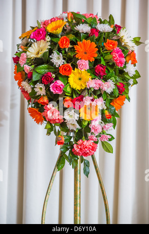 Flower bouquet isolated on white curtain in party room - Stock Photo