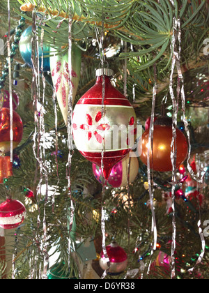 Tinsel and decorations on Christmas tree - Stock Photo