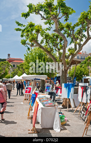 Original paintings on sale on the harbourside in Cannes, South of France - Stock Photo