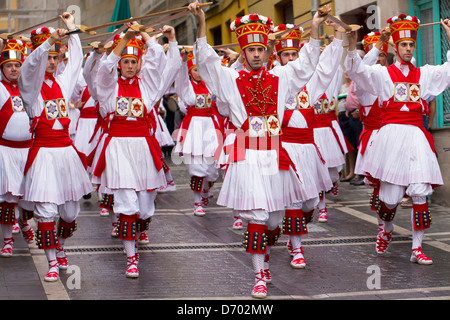 Dancers parading in procession through the streets during San Fermin Fiesta at Pamplona, Navarre, Northern Spain - Stock Photo