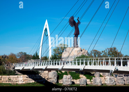 USA, Kansas, Wichita, Keeper of Plains sculpture and Arkansas River Pedestrian Bridges in Downtown - Stock Photo