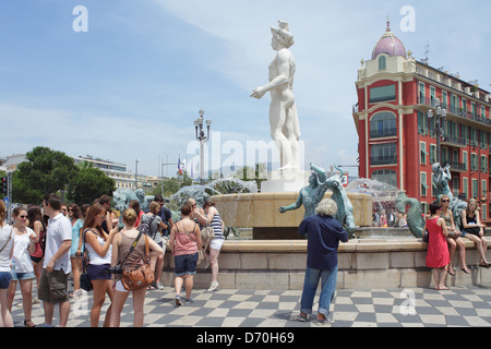 Nice, France, people sitting on the fountain in the Place Massena in Nice city center - Stock Photo