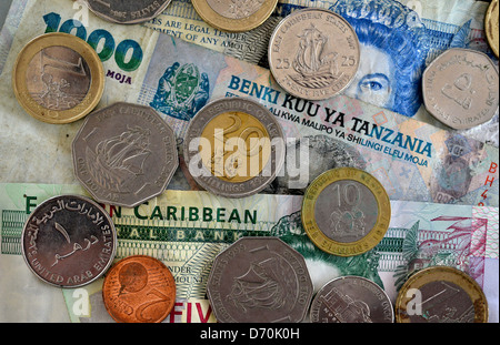 A selection of international currency coins and notes. - Stock Photo