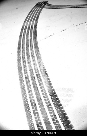 Grunge black tire track on white background - Stock Photo