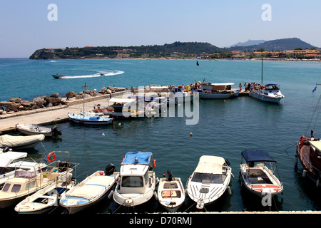 View over tourist and fishing boats in the harbour at Tsilivi resort, Zakynthos Island, Zante, Greece, Europe. - Stock Photo