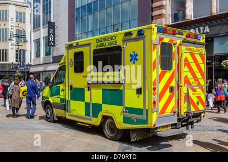 Yorkshire Ambulance Service ambulance on Briggate in the city centre, Leeds, West Yorkshire, UK - Stock Photo