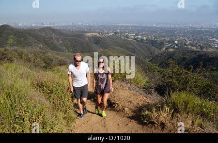 Couple hiking the Temescal Ridge Trail in Southern California - Stock Photo