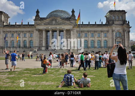 Berlin, Germany, tourists in front of the Reichstag on the Republic Square - Stock Photo