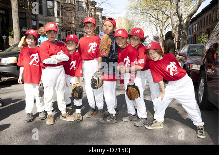 Team members await the start of the 2012 Little League Opening Day Parade in the Park Slope section of Brooklyn. - Stock Photo