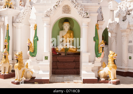 A Buddha statue in a stupa at Shwedagon Pagoda, Yangon, (Rangoon), Myanmar, (Burma) - Stock Photo