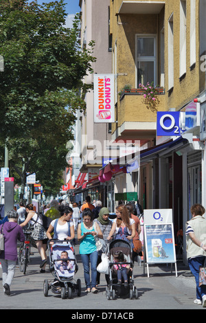 Berlin, Germany, passers-by on the main shopping street in the Muellerstrasse - Stock Photo