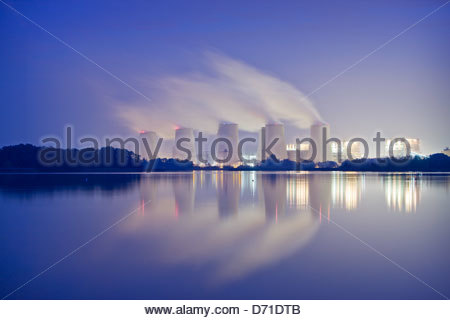 Power plant at lakeside - Stock Photo