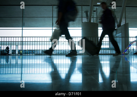 abstract airport and silhouette of people walking with luggage - Stock Photo