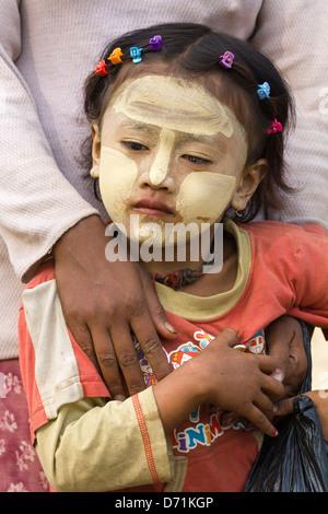 Little girl with Thanaka makeup in Nyaung oo Market in Bagan, Myanmar 4 - Stock Photo