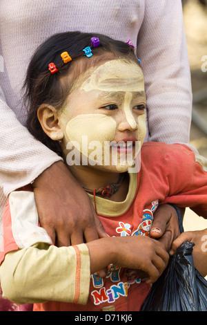 Little girl with Thanaka makeup in Nyaung oo Market in Bagan, Myanmar 3 - Stock Photo